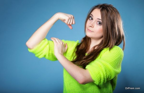 Girl shows her muscles