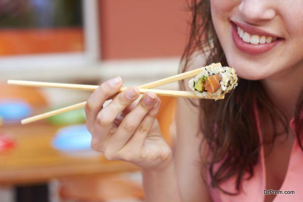 Female Eating Sushi
